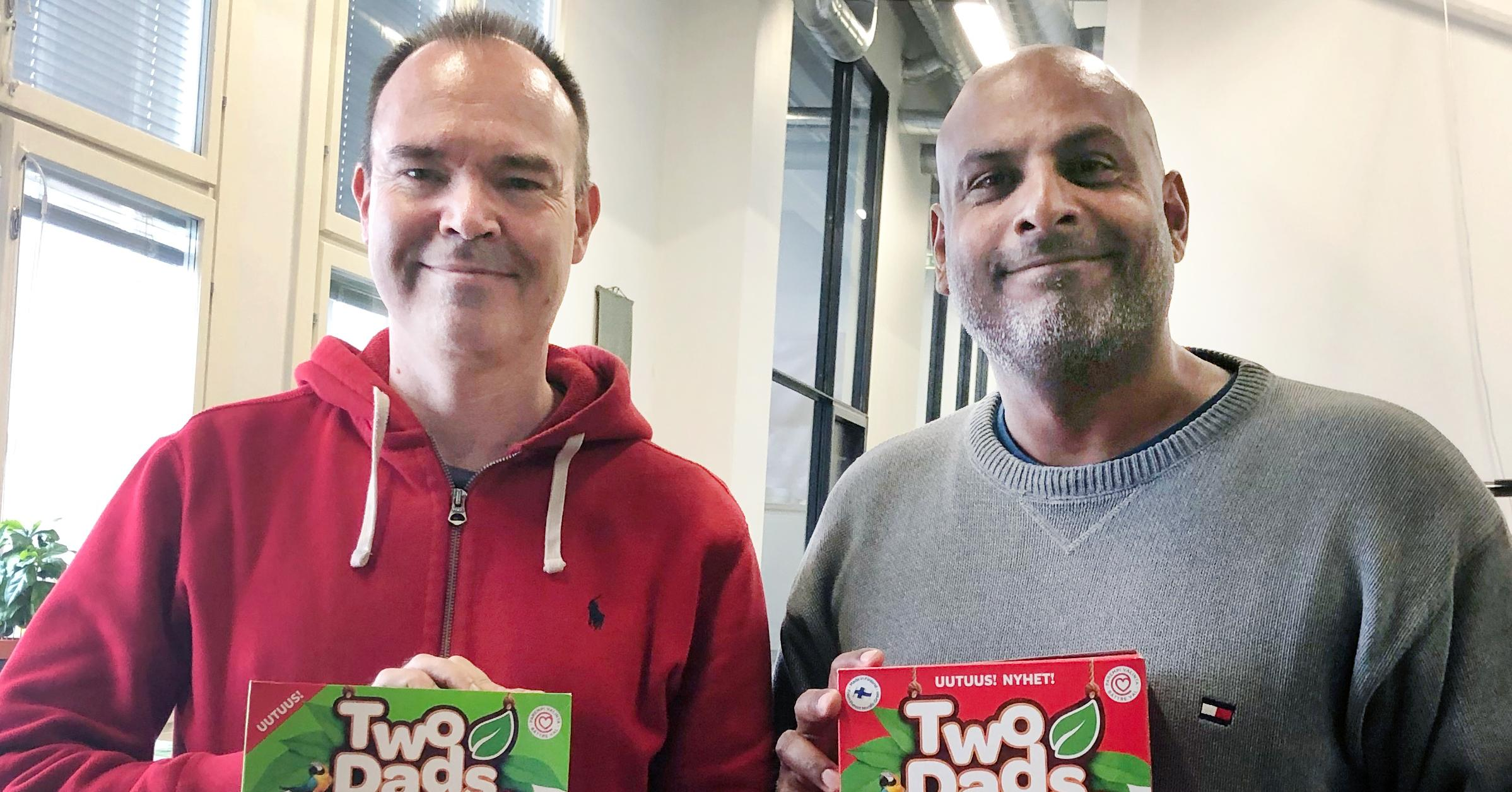 Peter Vesterbacka and Tino Singh holding TwoDads® breakfast cereals