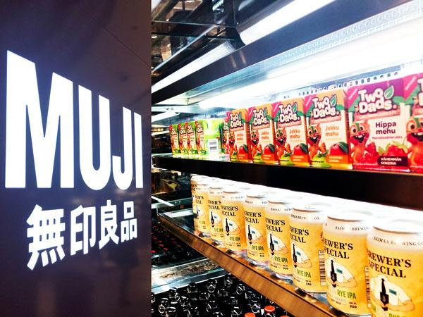 Muji logo and TwoDads® juices on a shelf
